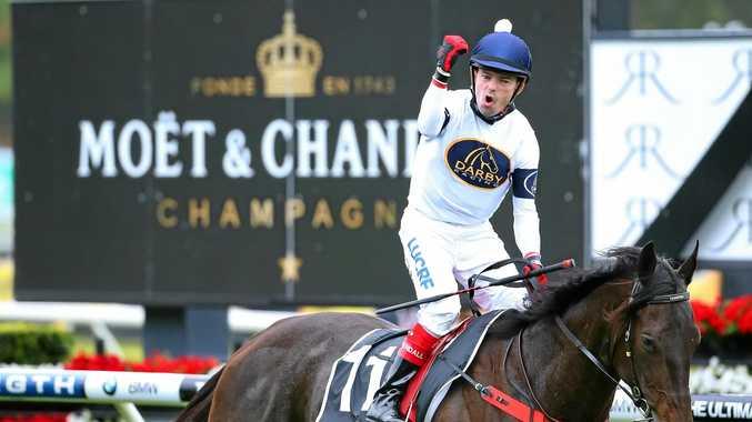 CHAMP: Jockey Dean Yendall on Yankee Rose celebrates winning the Moet & Chandon Spring Champion Stakes.