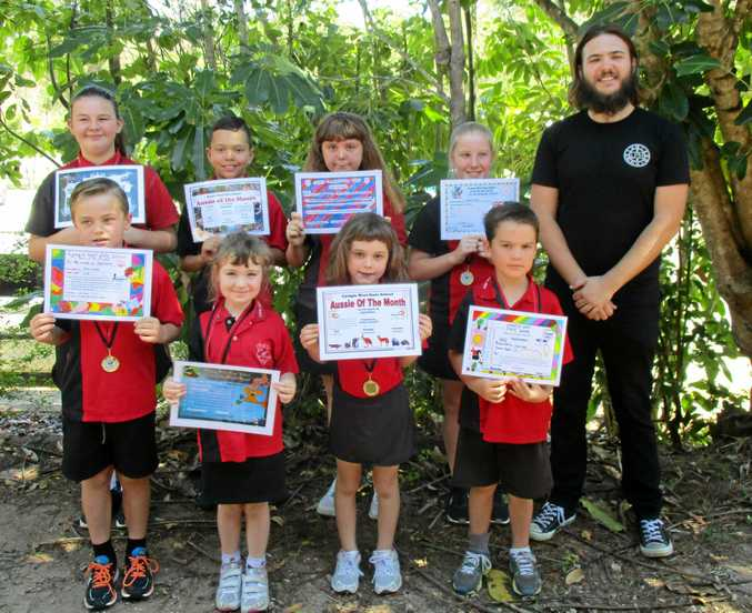 TOP LITTLE AUSSIES: Gympie West's September Aussies of the Month pictured with Gympie recording artist Linc Pelps are (back from left) Zoe Barron, Jackson Mann, Grace Visberg-Munro, Brooke Alford, (front) Isaac Ogden, Jaime White, Jasmine McConville and Zak King.