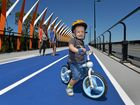 LINKING UP: Arie Evans, 2, is keen to get the first ride over the new Aura Boulevard Bridge at Caloundra South.