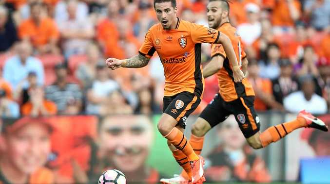 Jamie Maclaren of the Brisbane Roar controls the ball during the round-four A-League match against the Perth Glory at Suncorp Stadium.