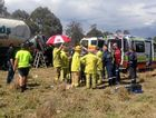 RACQ Care Flight crews and emergency service workers at the scene of the truck crash near Murgon in 2014.
