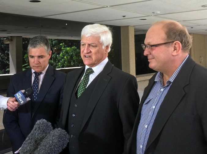 Rob Katter, Bob Katter and Shane Knuth address the media at Parliament House in Brisbane.