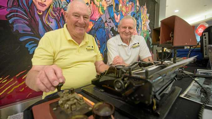 Les Edwards and Brian Mullins of Sydney are the Morsecodians, demonstrating their morse code ability during the Jacaranda Festival.