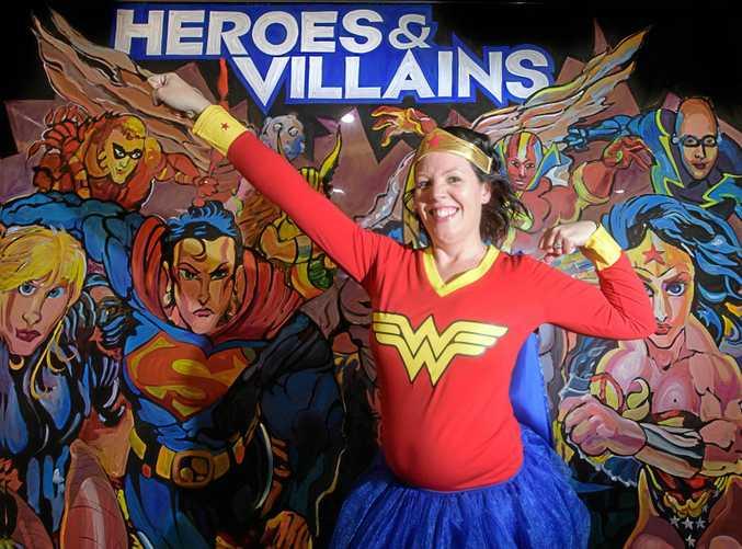 Jacaranda president Kristen Smith shows off her Wonder Woman outfit in preparation for Jacaranda Thursday at the Telstra Store Grafton.