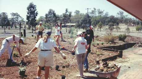 Supporters of The Haven carry out landscaping work as the facility was under construction 30 years ago.