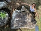 Ronald 'Reggie' Meloury with the rock he thinks looks like Queensland.