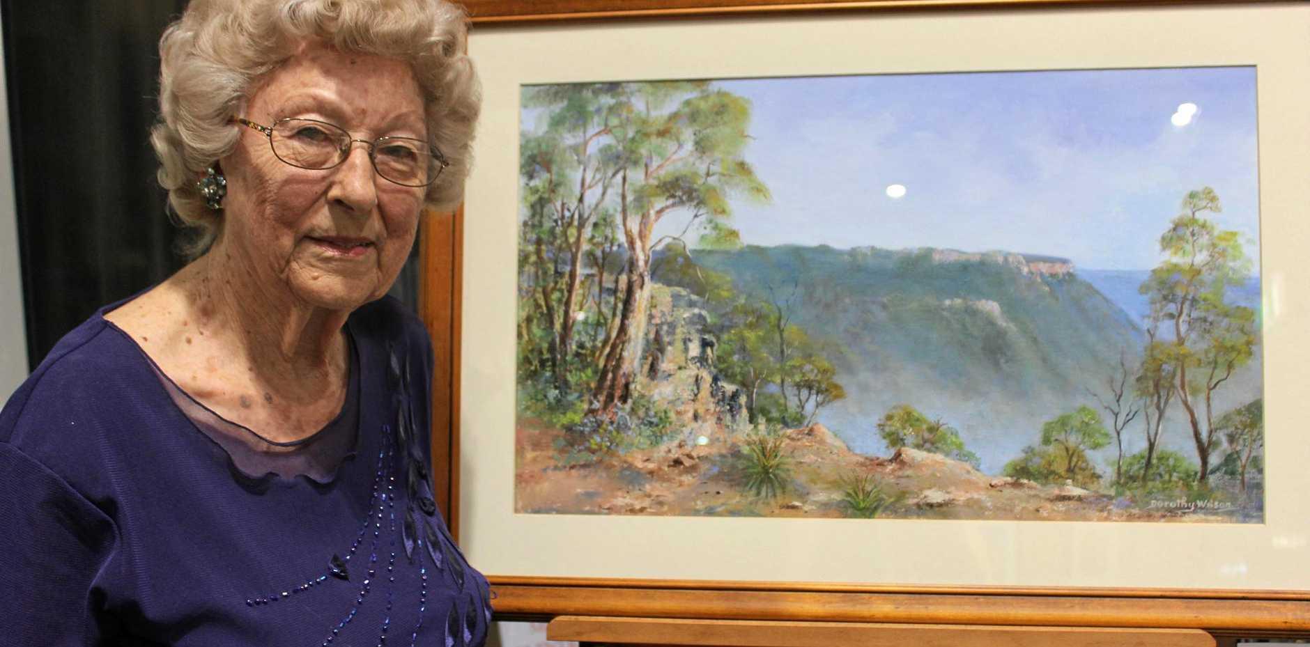ART SOCIETY: Blackwater Art Society life memeber Dorothy Wilson with her painting, Horseshoe Lookout.