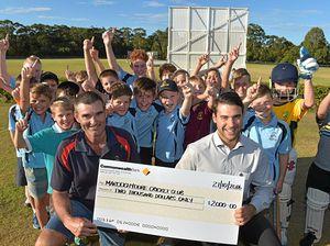 Junior cricketers cheering with CBA sponsorship
