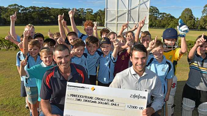 CHEERING:  Shane Kropp from Maroochydore Cricket Club accepts a cheque from Jared Klease from Commonwealth Bank, which will be put towards new gear and equipment.