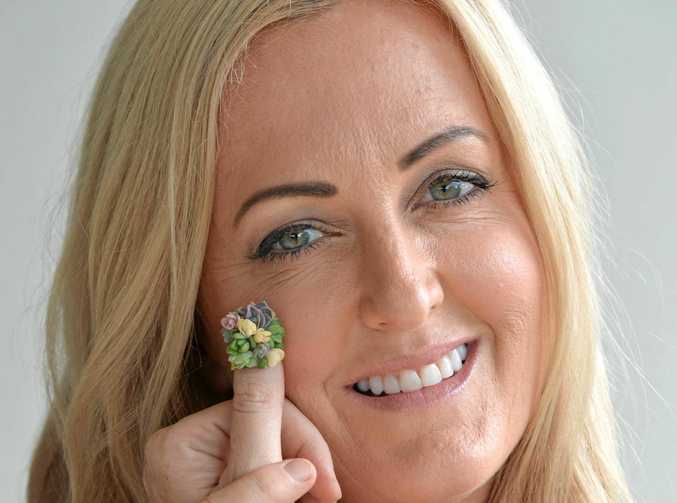 Arozona's Roz Borg shows an example of her succulent nail art.