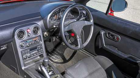 Inside the Mazda MX-5 NA.
