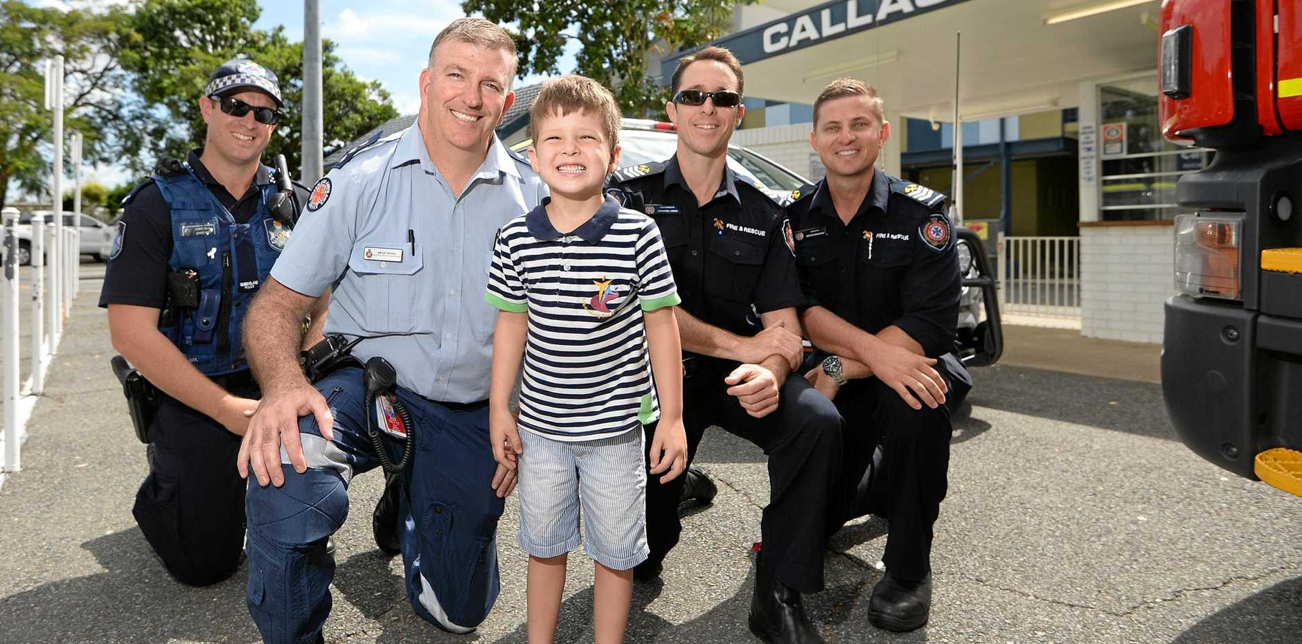 GOOD CAUSE: Four-year-old Hudson Muir with emergency services officers (from left) Constable James May, Brad Miers from the QAS and senior firefighters JP Logan and Ben Rutherford.