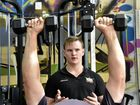 Owner of The Bar, Lochlan Wagner talks through weight training with participant, Darren Todd.