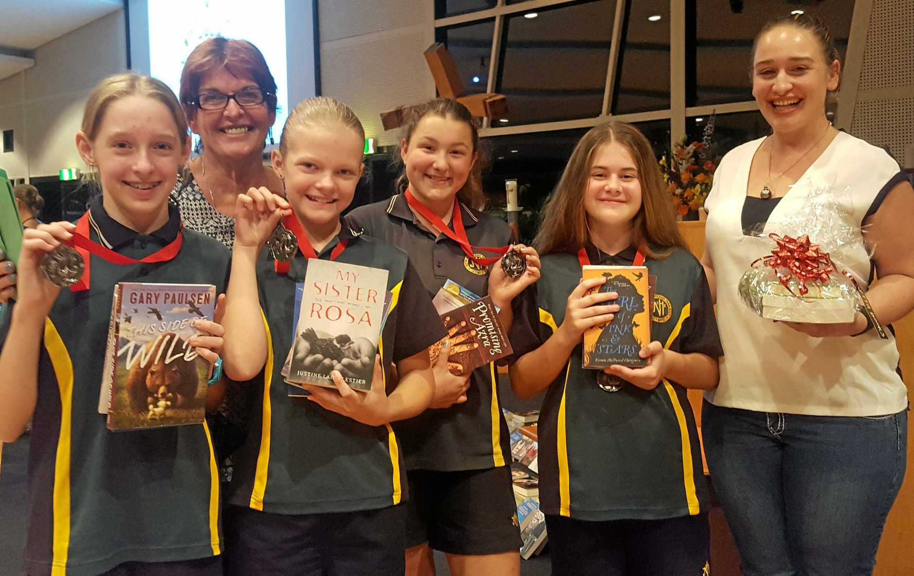 GREAT READ: James Nash State High's Year 7 reading team (from left) Jill Rollings, Ms Diana King, Aliyah Millard, Mikayla Lawler, Scarlett Mansfield and Ms Carolyn King.