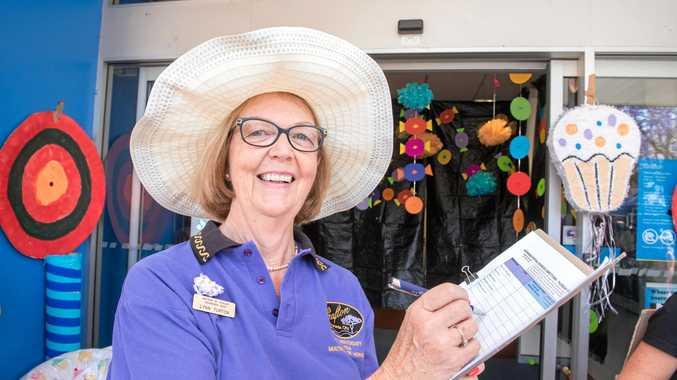 Lynn Turton judges the business dressups on Jacaranda Thursday.