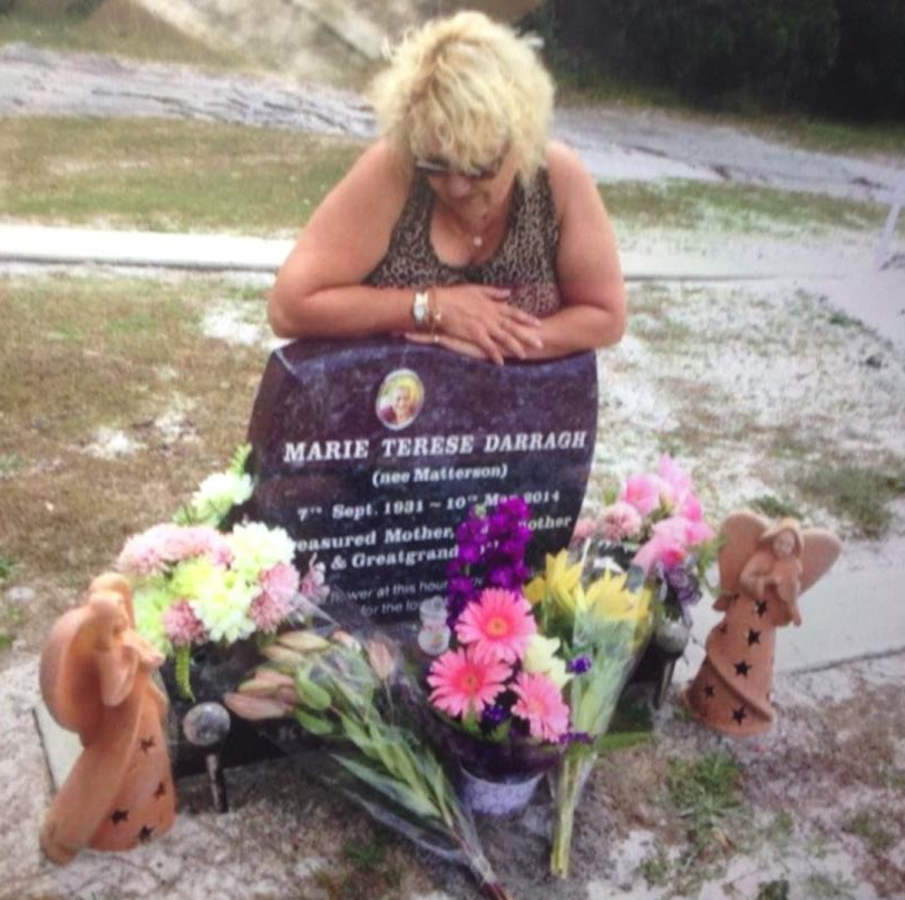 Charli Darragh at her mother Marie's grave. Nurse Megan Jean Haines has been found guilty of murdering the elderly woman and another St Andrew's aged care centre resident.