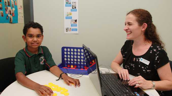 Hear and Say student Lachlan Jackson has fun in a mapping session with new audiologist Trinette Walmsley.