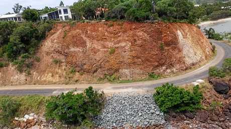 LAND SLIP: Aerial images show the damage to Statue Bay road nearly two years on from Cyclone Marcia.