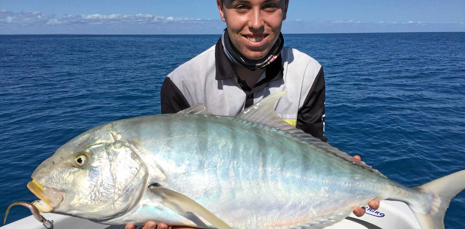 NICE ONE: Jack hooked this solid golden trevally, caught on a charter with Hervey Bay Fly and Sportfishing.