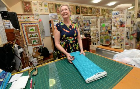 Dianne Jeha behind the counter at the Needlework Cottage.   Photo: Chris Ison / The Morning Bulletin