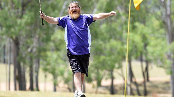 HOT SHOT: A jubilant Jai Browne celebrates after he chipped in during play at the charity golf day at the Mount Morgan Golf Club. Jai and his teammates won the three-ball ambrose.