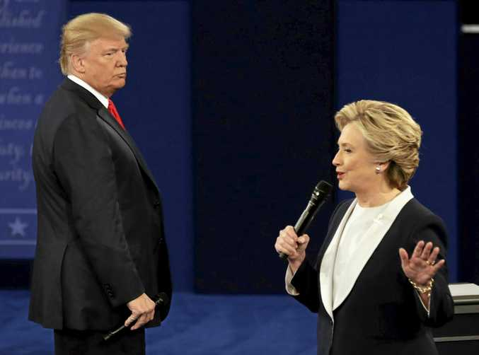 THE GLOVES ARE OFF: Republican presidential nominee Donald Trump listens to Democratic presidential nominee Hillary Clinton during the second presidential debate at Washington University in St. Louis.