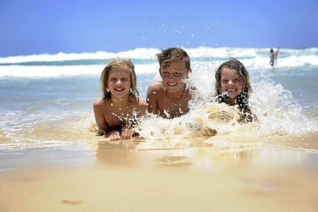 RAINBOW BEACH: Ella Gair, Marc Kinaldi and Edan Gair enjoy the waves.