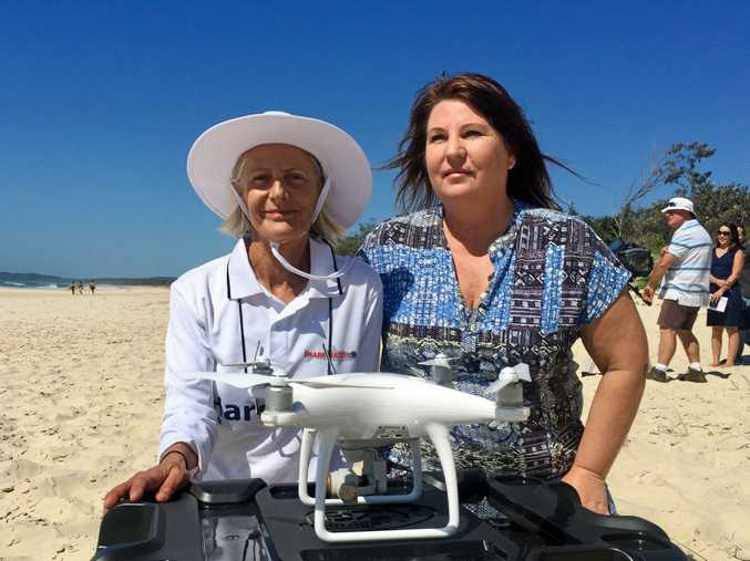 NON LETHAL: Founder of Shark Watch Ballina and marine ecologist Jann Gilbert with Ballina MP Tamara Smith with the drone that will be used to patrol at Tallow Beach Byron Bay.