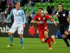 Neil Kilkenny of Melbourne (left) tackles Isaias of Adelaide during their round-four A-League match.