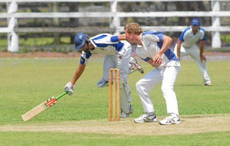 Harwood's Jacob McMahon stretches out to take a quick run towards the end of their innings against Tucabia at Ulmarra Showground.