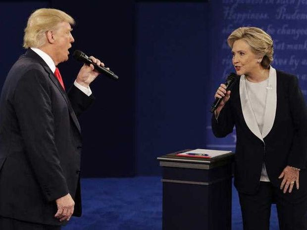 Republican presidential nominee Donald Trump and Democratic presidential nominee Hillary Clinton speak during the second presidential debate at Washington University in St. Louis.