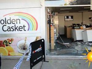 Car crashes through shopfront.