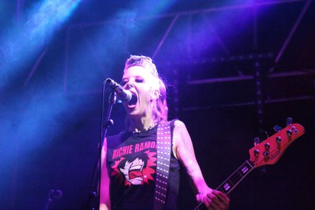 Richie Ramone's bass player Claire plays it up to the crowd in Airlie Beach last night.