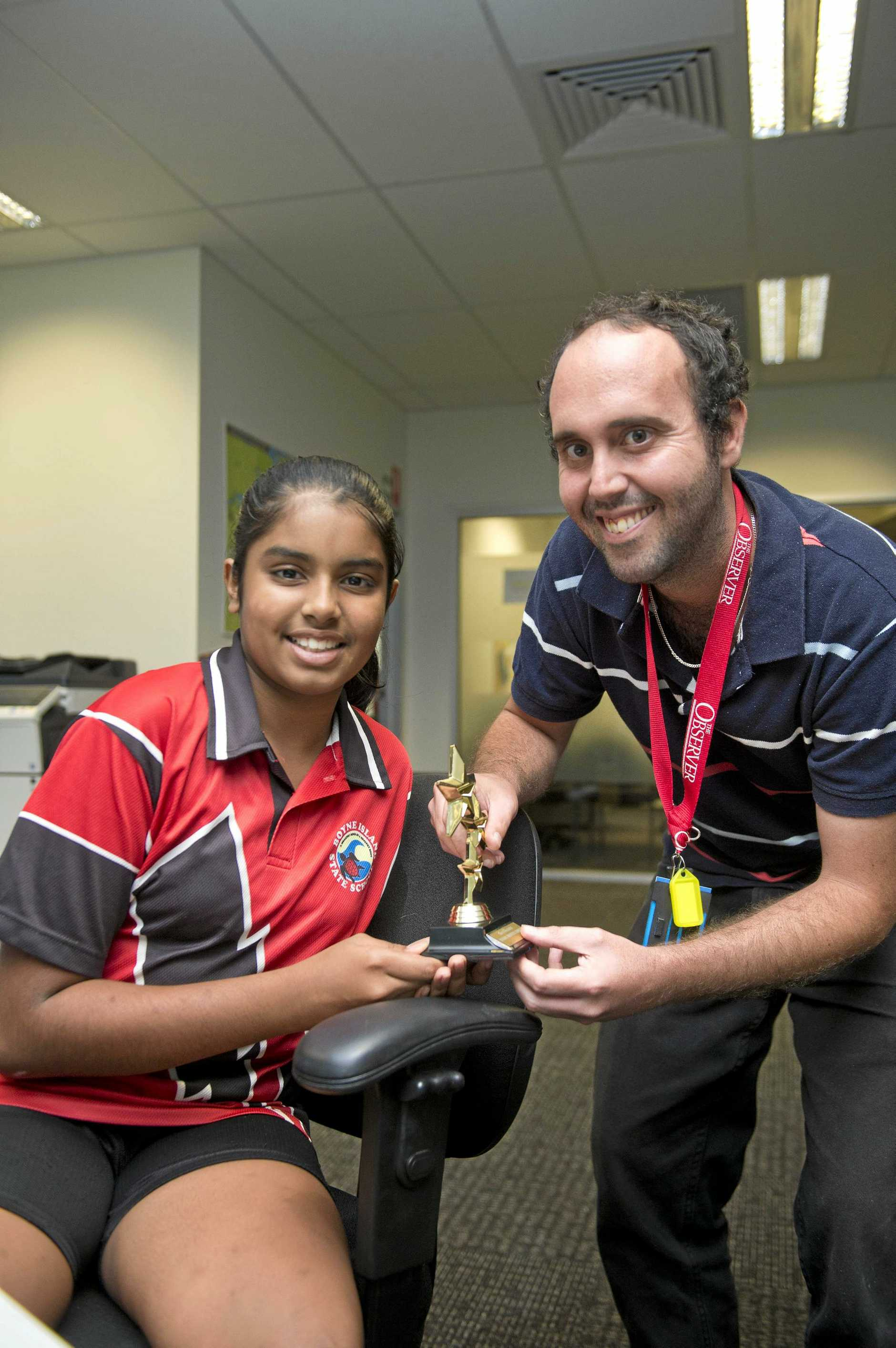 WINNER: Young Writers Award primary school winner Ria Moodley with The Observer's deputy editor Chris Lees.