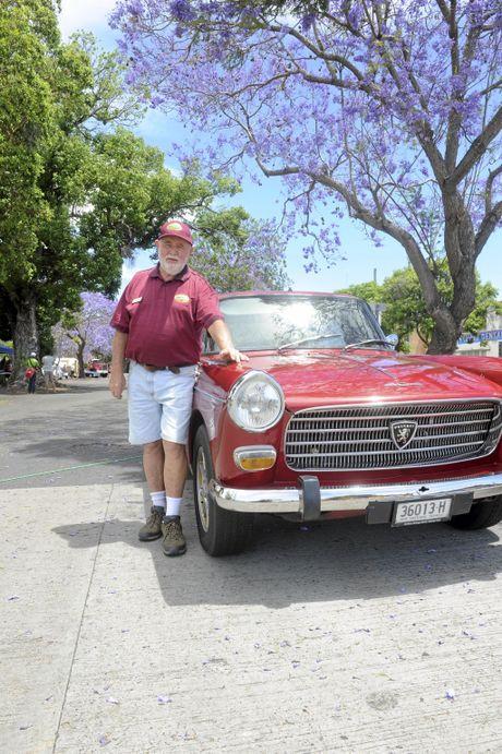 President of the Grafton Vintage Motor Vehicle Club Doug Clark with his Peuregot 404