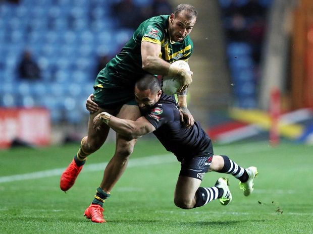 New Zealand's Jesse Bromwich tackles Australia's Blake Ferguson during their Four Nations rugby league match at the Ricoh Arena, Coventry.