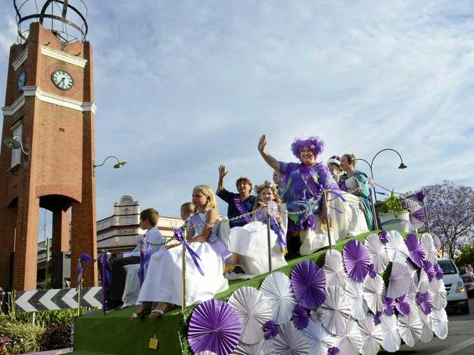 LEFT: The Jacaranda Queen's Party give the royal wave during the 82nd Jacaranda Float Parade down Prince St on Saturday.