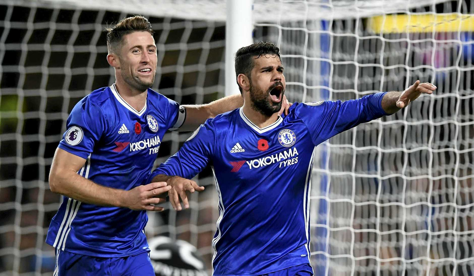 Chelsea's Diego Costa (right) is congratulated by teammate Gary Cahill after scoring against Everton.