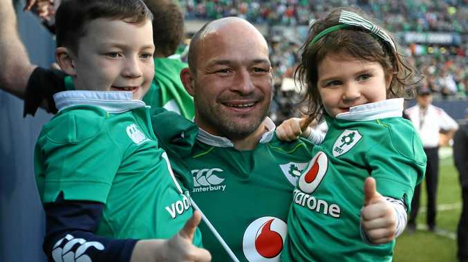 Rory Best of Ireland celebrates with his children following his team's 40-29 victory over New Zealand at Soldier Field.