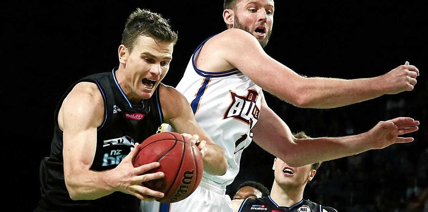 Kirk Penney of New Zealand competes against Anthony Petrie of Brisbane during their round-five NBL match.