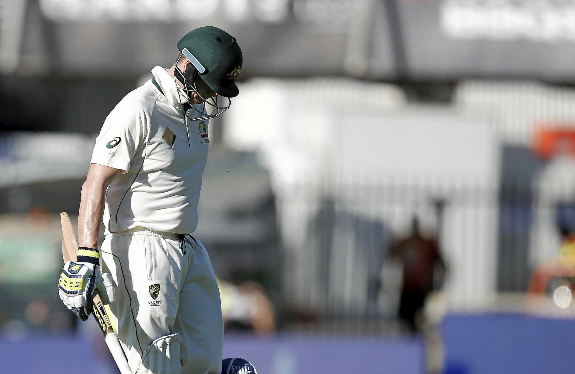 Australia's Steve Smith walks off the field after South Africa's Kagiso Rabada took his wicket on the fourth day of play.