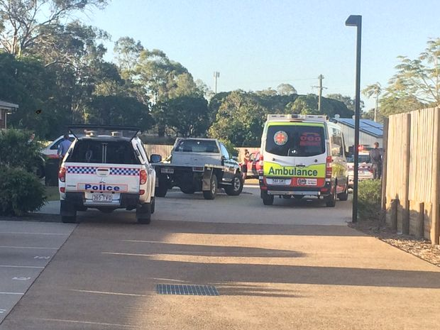 Gladstone Police and Queensland Ambulance Service are outside a home in Gladstone.