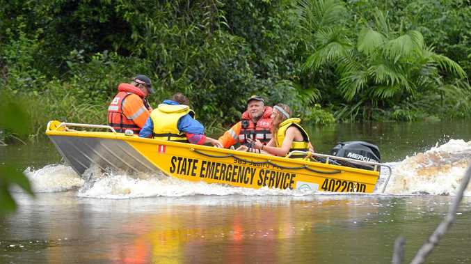ROCKHAMPTON: An SES flood boat ferries people stranded on the east side of Waterpark Creek in Byfield after heavy rains caused more than a metre of water flowing over the road this year.