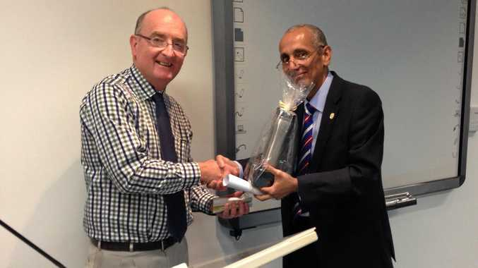 AWARD RECIPIENT: Dr Anthony Keating receiving his Clinical Teaching Excellence Award from Assoc Prof David Shaker.