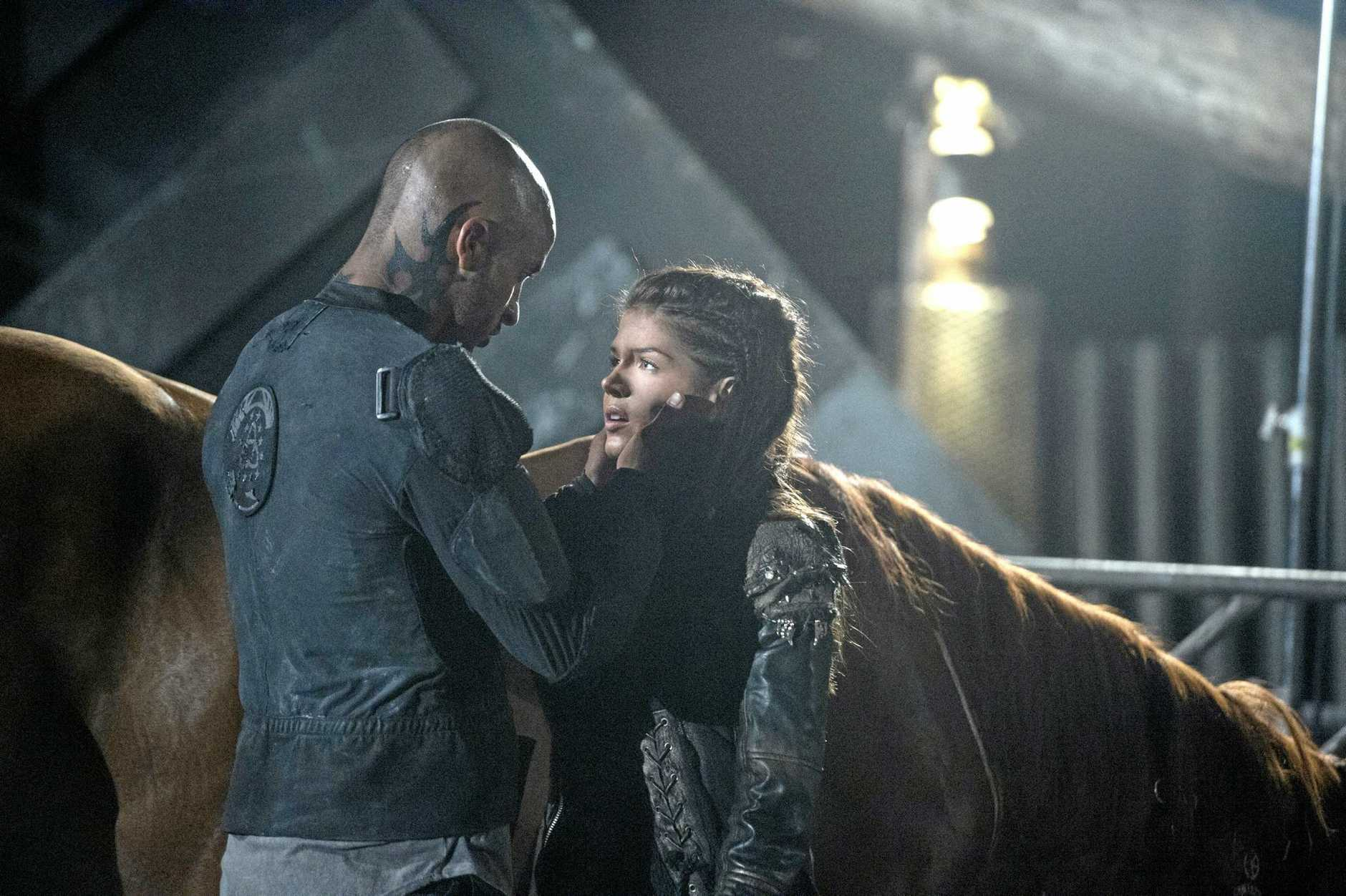 Ricky Whittle and Marie Avgeropoulos in a scene from the TV series The 100. Supplied by Foxtel.