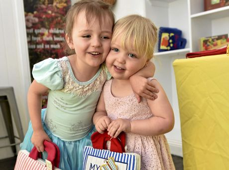 Little Toy Lane opens in the Australian Arcade is owned by Lisa Pearce.  Enjoying the books on sale are her daughters, Poppy and Annabelle Pearce. November 4, 2016