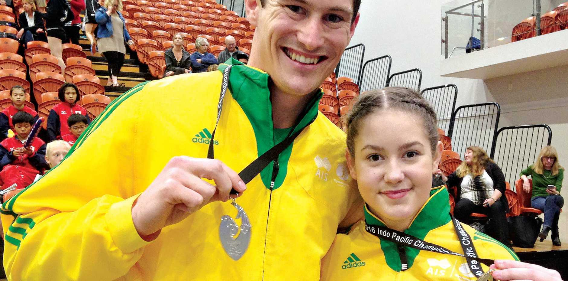 Victoria Park trampolinists Jarrod Spear and Britney Glazebrook with the medals they won at the 2016 Indo Pacific Championships.