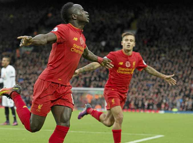 Liverpool's Sadio Mane (left) celebrates scoring the opening goal in the 6-1 win over Watford at Anfield.