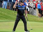 Rod Pampling celebrates after sinking a birdie on the 18th green to confirm his win.