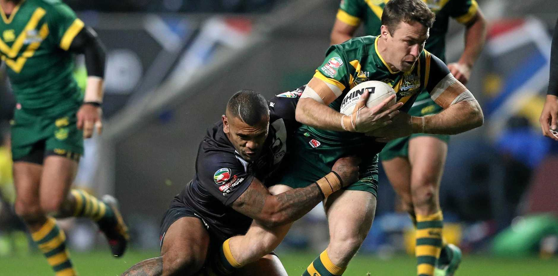 Australia's James Maloney is tackled by New Zealand's Manu Ma'u during the Four Nations rugby league match at the Ricoh Arena, Coventry, England, Saturday Nov. 5, 2016. (Simon Cooper/PA via AP)